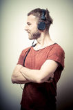 Vintage portrait of fashion guy with headphones Stock Images