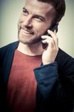 Vintage portrait of fashion guy on the phone Royalty Free Stock Photos