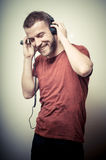 Vintage portrait of fashion smiling guy with headphones Stock Photo