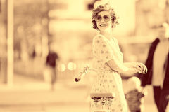 Vintage portrait of a girl with bike Stock Photos