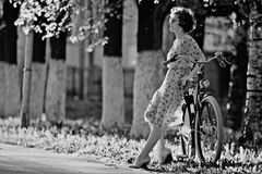 Vintage portrait of a girl with bike Royalty Free Stock Photos