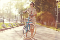 Vintage portrait of a girl with bike Royalty Free Stock Photography