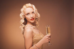 Vintage portrait of a girl with champagne. Stock Photos