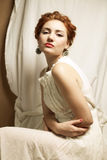 Vintage portrait of glamourous queen like girl in bedroom Royalty Free Stock Images