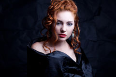 Vintage portrait of glamourous red-haired queen like girl Royalty Free Stock Images