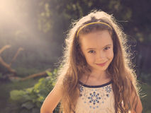 Vintage portrait of Happy little girl having fun at the park Stock Image