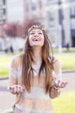 Vintage portrait of hippie young woman smiling with excitement. Stock Images