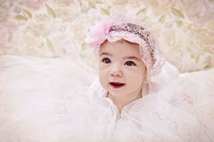 Vintage portrait of newborn baby girl in pink hat.  Royalty Free Stock Image