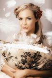 Vintage Portrait Of A Perfect Female Beauty. Soft Portrait Of A Young Beauty Woman In Vintage Fashion With Retro Hair Style And Natural Makeup Stock Photo