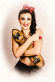Vintage portrait of a pin-up model with skateboard Royalty Free Stock Images