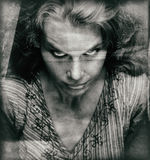 Vintage portrait of scary woman with evil face stock photography