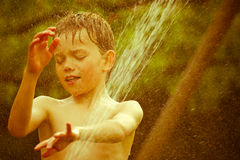 Vintage portrait of a young child. Playing with water stock photos