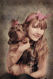 Vintage portrait of young girl with her dog. Vintage studio portret of beautiful young girl with her yorkshire dog Stock Images