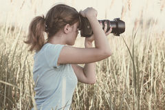 Vintage portrait of a young girl photographer working in the field of professional photographic equipment Stock Photos