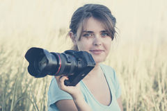 Vintage portrait of a young nature photographer to shoot in the field on photographic equipment Royalty Free Stock Photography