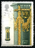 Vintage Post Box UK Postage Stamp. GREAT BRITAIN - CIRCA 2002: A used postage stamp from the UK, depicting an illustration of a vintage Victorian Post Box - from Royalty Free Stock Image