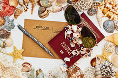 Vintage post card, passport and sunglasses with sea shells and n stock photos