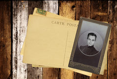Vintage post cards and retro photo on old wooden planks Royalty Free Stock Images