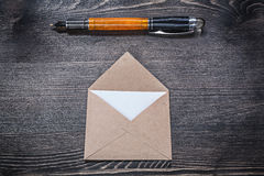 Vintage post envelope fountain pen on wooden board Royalty Free Stock Photo