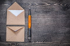 Vintage post envelopes fountain pen on wooden board copyspace Stock Photography