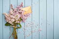 Vintage postage envelope in blooming gentle bouquet Stock Photos