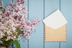 Vintage postage envelope with card and summer bouquet of lilac Stock Images