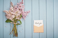 Vintage postage envelope with card and summer bouquet of lilac Royalty Free Stock Images