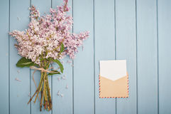 Vintage postage envelope and summer bouquet of lilac Royalty Free Stock Images