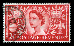 Vintage Postage Stamp Celebrating Queen`s Coronation. UNITED KINGDOM, CIRCA 1953: A vintage British postage stamp celebrating the Coronation of Queen Elizabeth Stock Image