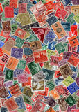 Vintage postage stamps. Background of old postage stamps from different countries stock image