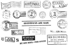 Vintage postal marks. A set of nineteen large postal marks mostly from the 1930s and 1940s isolated on white. Ideal for photoshop brushes, retro collages, etc Stock Images