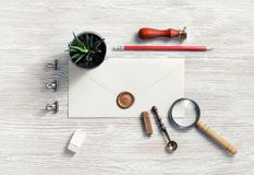 Vintage postal stationery. And blank envelope on light wooden background. Responsive design mock up. Flat lay royalty free stock photography
