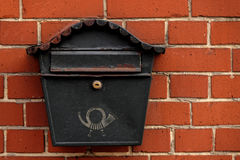 Vintage postbox on brick wall Royalty Free Stock Photography