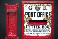 Vintage postbox weathered by age in English town Royalty Free Stock Image
