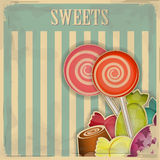 Vintage postcard. Sweet candy on striped background - illustration Stock Photography