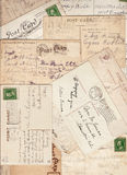 Vintage Postcard Assortment Background. A group of turn of the century antique postal card backs.  Many with cancelled one cent stamps, addresses, greetings and Royalty Free Stock Photos