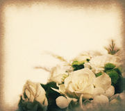 Vintage postcard with copy space, white roses bouquets, soft light on paper texture. Royalty Free Stock Image