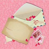 Vintage postcard, envelope, post stamps, paper hearts. Background for Valentines Day or wedding design Stock Photos