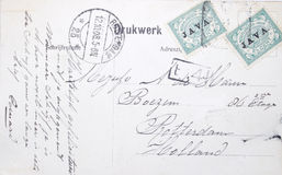 Vintage postcard of 1908 from Java to The Netherlands. Vintage postcard sent from Java in the East Indies with address in the Netherlands postmarked Rotterdam Royalty Free Stock Image