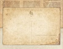 Vintage postcard on the old newspaper background. Vintage postcard on the old newspaper texture background royalty free stock photo
