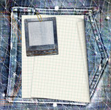 Vintage postcard with paper slides on old jeans Stock Images