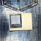 Vintage postcard with paper slides on old jeans Stock Photo