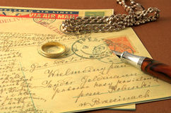 Vintage postcard and pen 2. Romance vintage postcard and golden ring and pen Royalty Free Stock Images