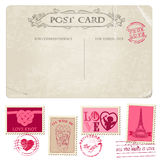 Vintage Postcard and Postage Stamps Stock Photos