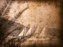 Vintage postcard with sailboat. Vintage postcard with a sailboat and palm tree Stock Photos