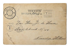 Vintage postcard sent in 1900 from the USA. Vintage postcard of 1900 with handwritten address in the Netherlands sent from the USA and postmarked in Hoboken (USA royalty free stock image