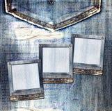 Vintage postcard with slides on old jeans Stock Image