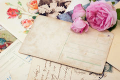 Vintage postcards with rose. Group of vintage postcards, rose and empty one in the centre Stock Image
