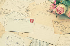 Vintage postcards and soft rose flowers. nostalgia Royalty Free Stock Image