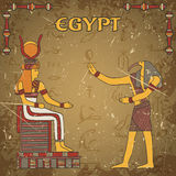 Vintage poster with egyptian god and pharaoh on the grunge background with silhouettes of the ancient egyptian hieroglyphs. Retro hand drawn vector Stock Images